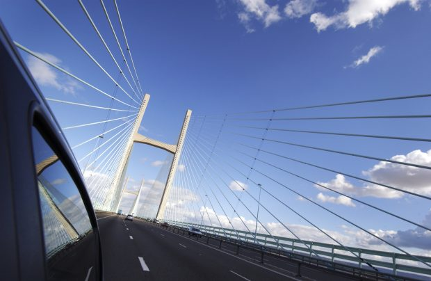 The Second Severn Crossing, Bristol. Long shot of suspension bridge alongside vehicle.